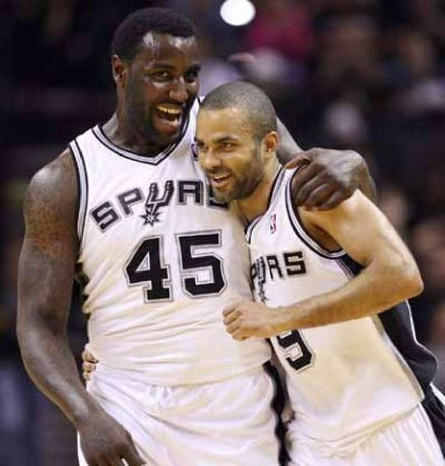 FOR SPORTS - Spurs' DeJuan Blair hugs teammate Tony Parker after Parker scored a three pointer against the Kings during second half action Friday March 11, 2011 at the AT&T Center. The Spurs won 108-103.  (PHOTO BY EDWARD A. ORNELAS/eaornelas@express-news.net) (SAN ANTONIO EXPRESS-NEWS)