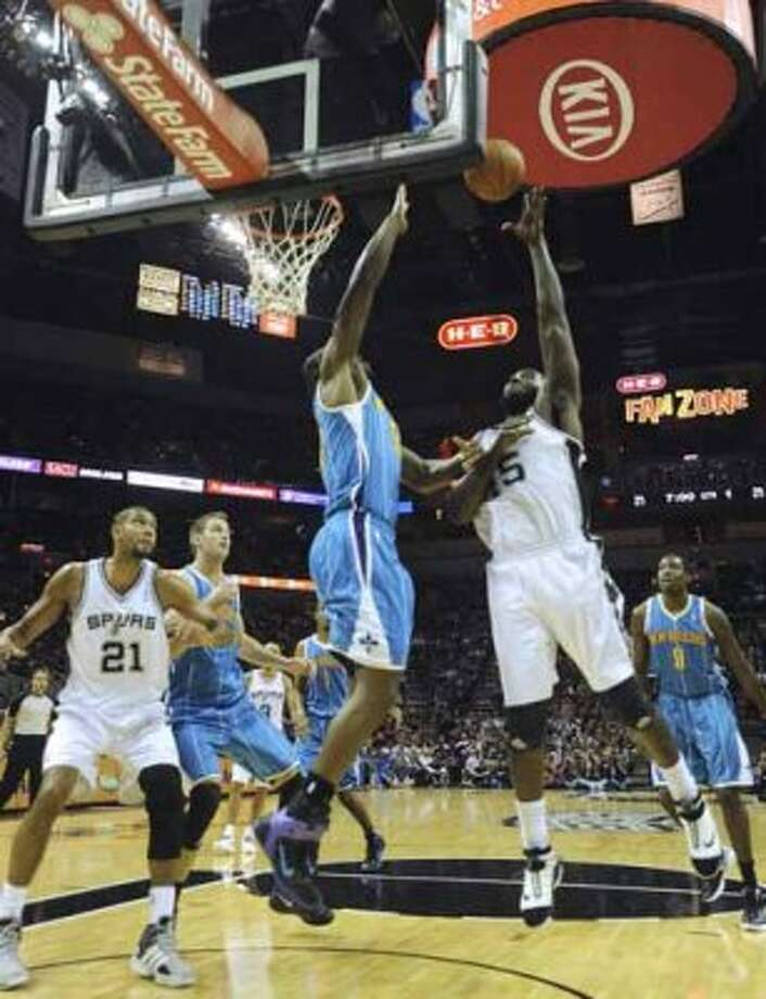 DeJuan Blair of the Spurs, right, shoots over Emeka Okafer of the New Orleans Hornets during NBA action at the AT&T Center on Thursday, Feb. 2, 2012.  Billy Calzada / San Antonio Express-NewsNew Orleans Hornets at San Antonio Spurs (San Antonio Express-News)