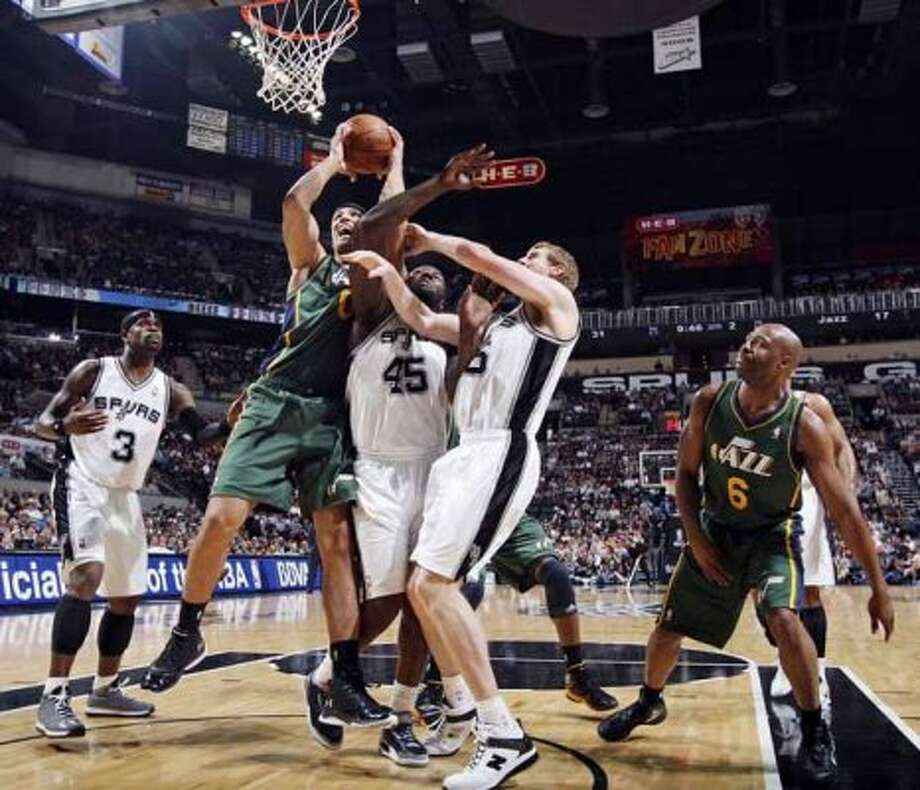 FOR SPORTS - Utah Jazz Enes Kanter struggles for a rebound against San Antonio Spurs DeJuan Blair and Matt Bonner as San Antonio Spurs Stephen Jackson (left) and Utah Jazz Jamaal Tinsley (right) look on during first half action of Game 2 of the Western Conference first round Wednesday May 2, 2012 at the AT&T Center.  (PHOTO BY EDWARD A. ORNELAS/SAN ANTONIO EXPRESS-NEWS) (SAN ANTONIO EXPRESS-NEWS)