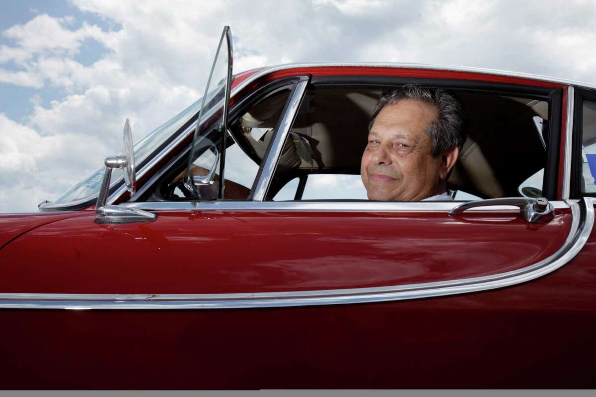 Irv Gordon poses for a picture in his Volvo P1800 in Babylon, N.Y., Monday, July 2, 2012. Gordon's car already holds the world record for the highest recorded milage on a car and he is less than 40,000 miles away from passing three million miles on the Volvo.
