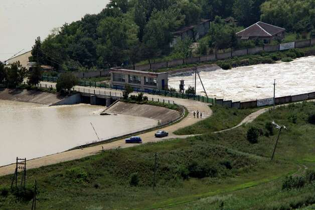This Sunday, July 8, 2012 photo shows an overall view of the Varnavinskoye reservoir near the city of Krymsk. The water rushed into Krymsk early Saturday with such speed and volume that residents said they suspected that water had been intentionally released from a reservoir in the mountains above, a claim government officials deny. (AP Photo/Vladimir Smolyakov) Photo: Vladimir Smolyakov, Associated Press / AP