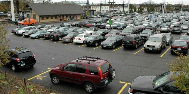In this Nov. 5, 2010 photo, cars fill the commuter parking lot at the railroad station off Unquowa Road in Fairfield, Conn. While money has been spent on a new fleet of trains and other improvements along the Metro-North rail line, commuters say the perennial parking shortage remains a challenge. (AP Photo/Connecticut Post, Cathy Zuraw) MANDATORY CREDIT Photo: Cathy Zuraw, Associated Press / Connecticut Post