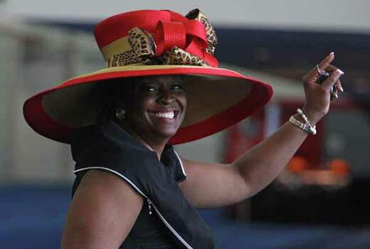 Debra Lockett of Houston attends Sunday's events at the George R. Brown Convention Center. Photo: James Nielsen, . / © Houston Chronicle 2012
