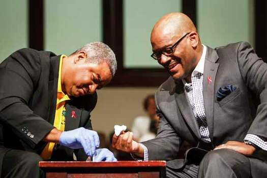 """The NAACP, Bee Busy Wellness Center, and Rev. Timothy Sloan of St. Luke Missionary Baptist Church sponsored the """"Day of Unity"""" to mobilize faith leaders to talk about HIV/AIDS. Photo: Michael Paulsen, . / © 2012 Houston Chronicle"""