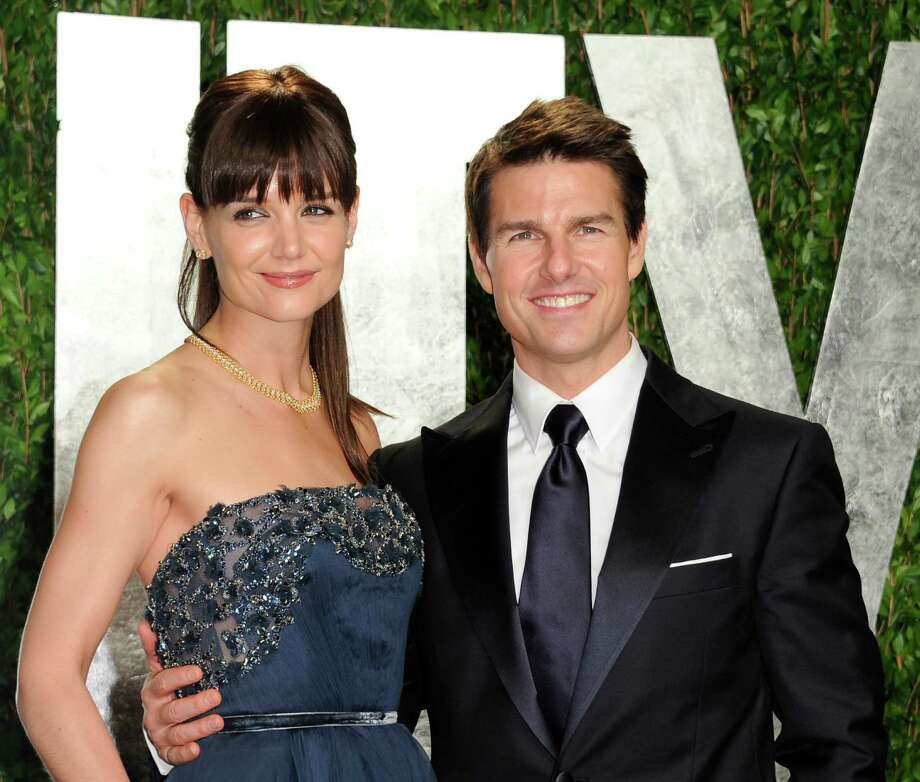 FILE - In this Feb. 26, 2012 file photo, actors Tom Cruise and Katie Holmes arrive at the Vanity Fair Oscar party, in West Hollywood, Calif.  Cruise and Holmes have reached an agreement in their divorce case, according to her attorney. Holmes' attorney Jonathan Wolfe said in a statement Monday, July 9, that the case has been settled and an agreement was signed. Holmes filed for divorce less than two weeks ago, putting an end to the romance that began in 2005. The couple has a 6-year-old daughter, Suri. (AP Photo/Evan Agostini, File) Photo: Evan Agostini