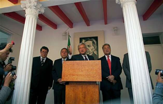 Andres Manuel Lopez Obrador, presidential candidate for the Democratic Revolution Party (PRD), center,  speaks during a news conference in Mexico City, Friday, July 06, 2012. The official count in Mexico's presidential election concluded Friday with results showing that presidential candidate Enrique Pena Nieto of the Institutional Revolutionary Party, or PRI,  got about 3.3 million more votes than his closest rival, Lopez Obrador, giving him a 6.6 percent lead in the former ruling party's bid to regain power. Lopez Obrador said Friday he will challenge the results. At left is Democratic Revolution Party's (PRD) campaign manager Ricardo Monreal, second from left  PRD President Jesus Sambrano and at right Labor Party's leader Alberto Anaya. (AP Photo/Alexandre Meneghini) Photo: Alexandre Meneghini, Associated Press / AP