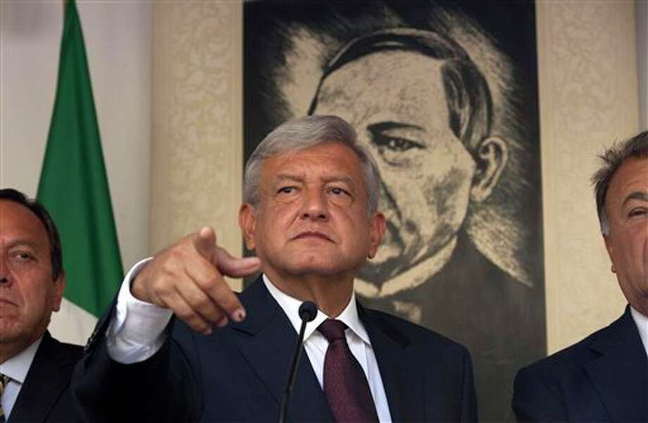 Andres Manuel Lopez Obrador, presidential candidate for the Democratic Revolution Party (PRD), speaks during a news conference in Mexico City, Friday, July 06, 2012. The official count in Mexico's presidential election concluded Friday with results showing that presidential candidate Enrique Pena Nieto of the Institutional Revolutionary Party, or PRI,  got about 3.3 million more votes than his closest rival, Lopez Obrador, giving him a 6.6 percent lead in the former ruling party's bid to regain power. Lopez Obrador said Friday he will challenge the results.(AP Photo/Alexandre Meneghini) Photo: Alexandre Meneghini, Associated Press / AP