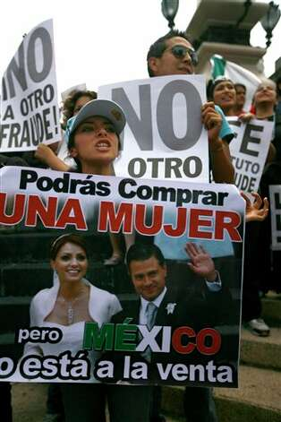 "Mexicans unhappy with the presidential election results gather around the Angel of Independence monument, in Mexico City, Saturday, July 7, 2012. The protestors marched in rejection of the final count in the presidential election showing former ruling party candidate Enrique Pena Nieto as the victor. They believe the PRI engaged in vote-buying that illegally tilted millions of votes. PRI officials deny the charge. The banner the woman is holding reads in Spanish; ""You can buy a woman, but Mexico is not for sale."" (AP Photo/Marco Ugarte) Photo: Marco Ugarte, Associated Press / AP2012"