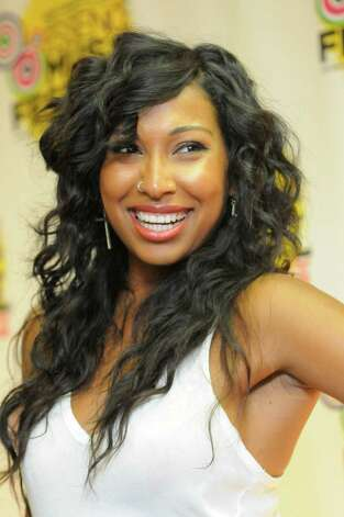 Melanie Fiona poses for photos at the Essence Music Festival in New Orleans on Sunday, July 8, 2012.  (Photo by Cheryl Gerber/Invision/AP) Photo: Cheryl Gerber, INVL / 2012 Invision