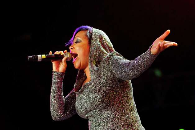 Monifah Carter performs at the Essence Music Festival in New Orleans on Sunday, July 8, 2012.  (Photo by Cheryl Gerber/Invision/AP) Photo: Cheryl Gerber, INVL / 2012 Invision