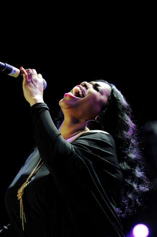 Nicci Gilbert performs a tribute to Whitney Houston at the Essence Music Festival in New Orleans on Sunday, July 8, 2012.  (Photo by Cheryl Gerber/Invision/AP) Photo: Cheryl Gerber, INVL / 2012 Invision
