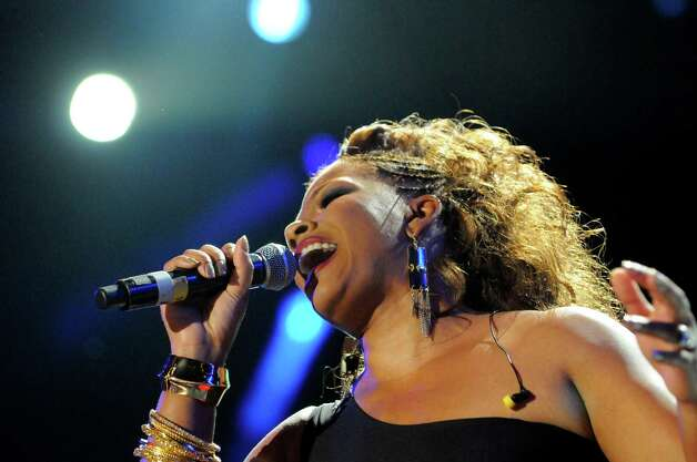 Syleena Johnson performs a tribute to Whitney Houston at the Essence Music Festival in New Orleans on Sunday, July 8, 2012.  (Photo by Cheryl Gerber/Invision/AP) Photo: Cheryl Gerber, INVL / 2012 Invision