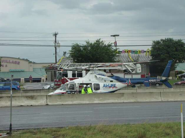 A man is flown to an area hospital following a wreck that killed a young boy on U.S. 281 near Brook Hollow Boulevard early Monday. Photo: Ana Ley/Express-News