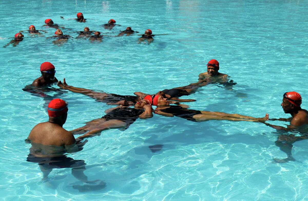 Members of the Honeys and Bears senior synchronized swim group perform at Harlem's Thomas Jefferson Park pool in New York, Monday, July 9, 2012. The group, founded in 1979, has 10 men and 31 women aged 62 to 100 who meet at least twice a week to practice.
