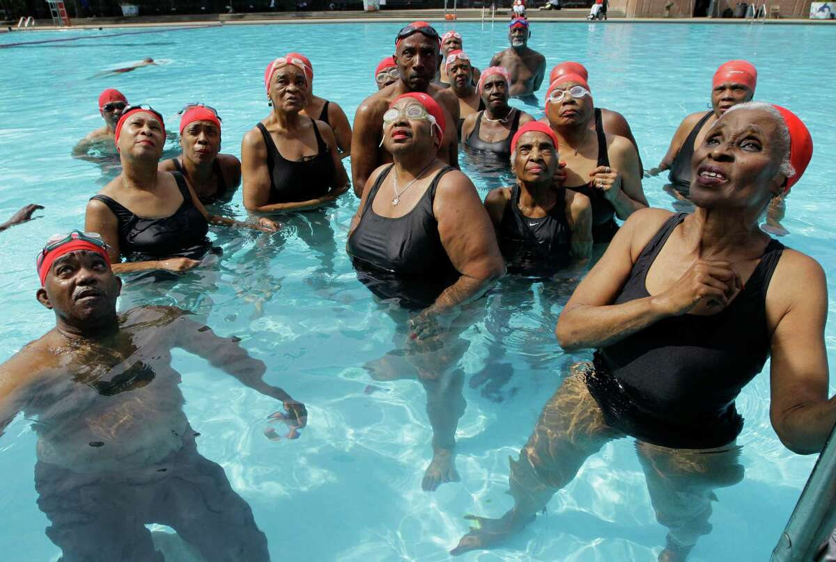 Members of the Honeys and Bears synchronized swim group gather for directions from their coach Oliver Foote at Harlem's Thomas Jefferson Park pool in New York, Monday, July 9, 2012. The group, which started in 1979, now has 41 members-10 men and 31 women-who range in age from 62 to 100 years old.