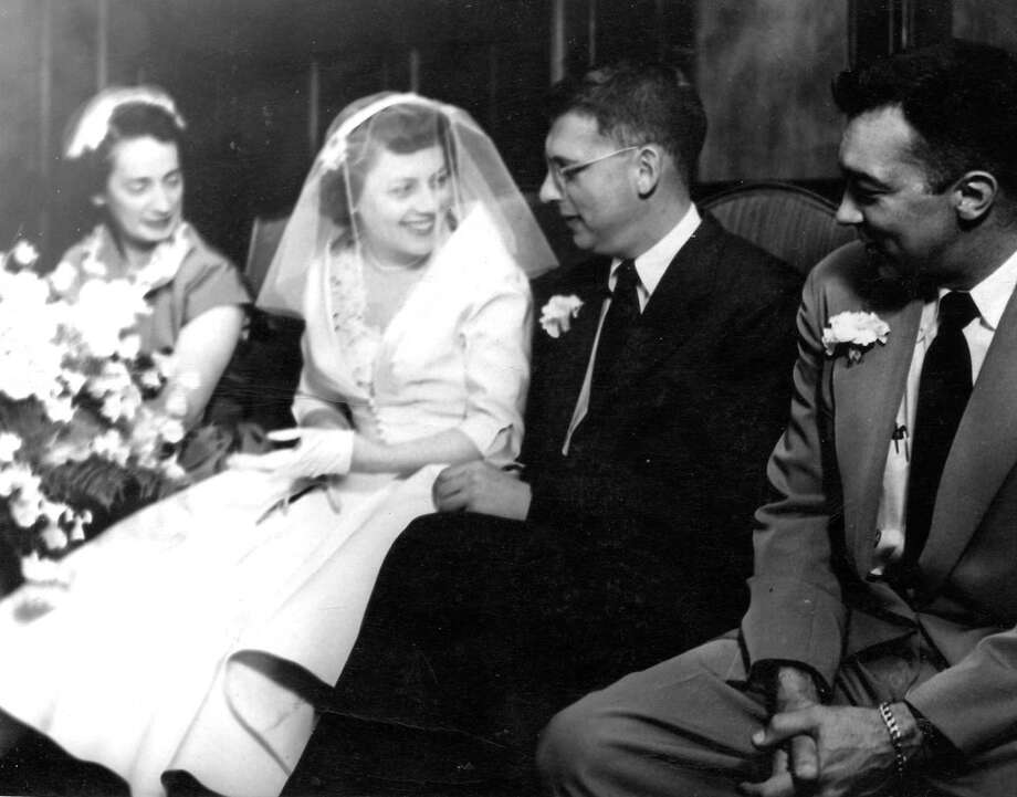 Roy Rowan, then Rome Bureau Chief of LIFE magazine, sits with his bride, Helen Rowan, a LIFE picture researcher after their marriage in Frankfurt, Germany on May 19, 1952. Photo: Contributed Photo