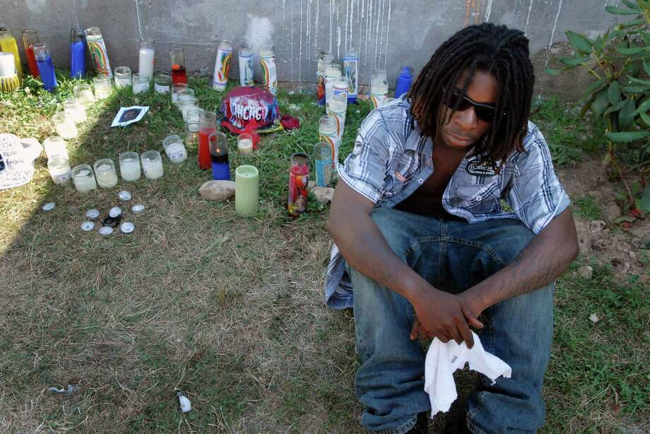 Richie Rinvid, 18, pays his respects at memorial for his friend Darius Jones on Custer St. in Stamford, Conn. on Monday July 9, 2012. Jones was shot and killed on Sunday. Photo: Dru Nadler / Stamford Advocate Freelance