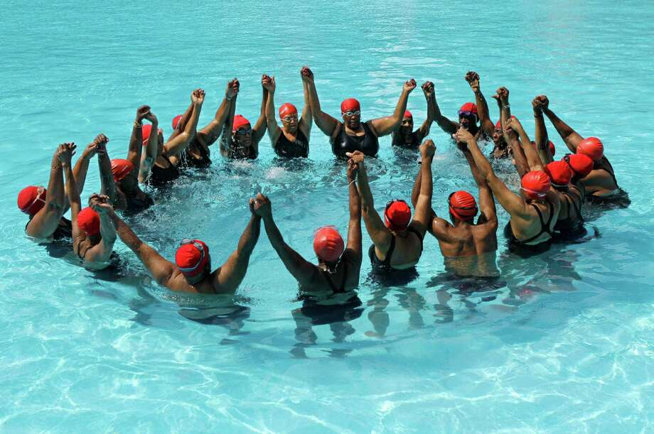 Members of the Honeys and Bears senior synchronized swim group perform at Harlem's Thomas Jefferson Park pool in New York, Monday, July 9, 2012. The group, which started in 1979, now has 41 members-10 men and 31 women-who range in age from 62 to 100 years old. ( Photo: Kathy Willens, AP / AP