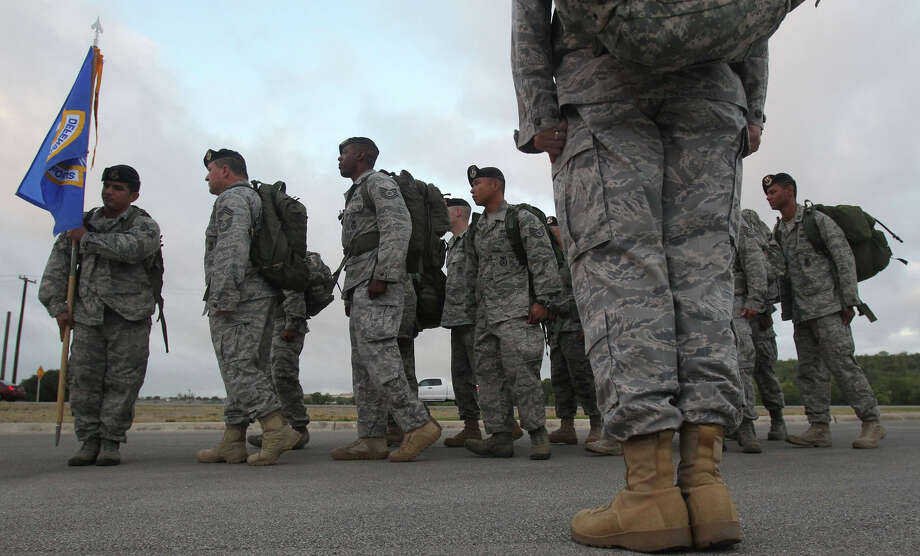 "Joint Base San Antonio Airmen embark on the first leg of the ""Ruck March to Remember"" at Lackland Air Force Base Tuesday July 12, 2011. The march kicked off at Lackland and will finish at Ground Zero in New York September 11, 2011 in remembrance of the terrorist attacks in 2001 and also to honor those who have fallen since the start of Operation Enduring Freedom. JOHN DAVENPORT/jdavenport@express-news.net Photo: JOHN DAVENPORT, SAN ANTONIO EXPRESS-NEWS / SAN ANTONIO EXPRESS-NEWS (Photo can be sold to the public)"