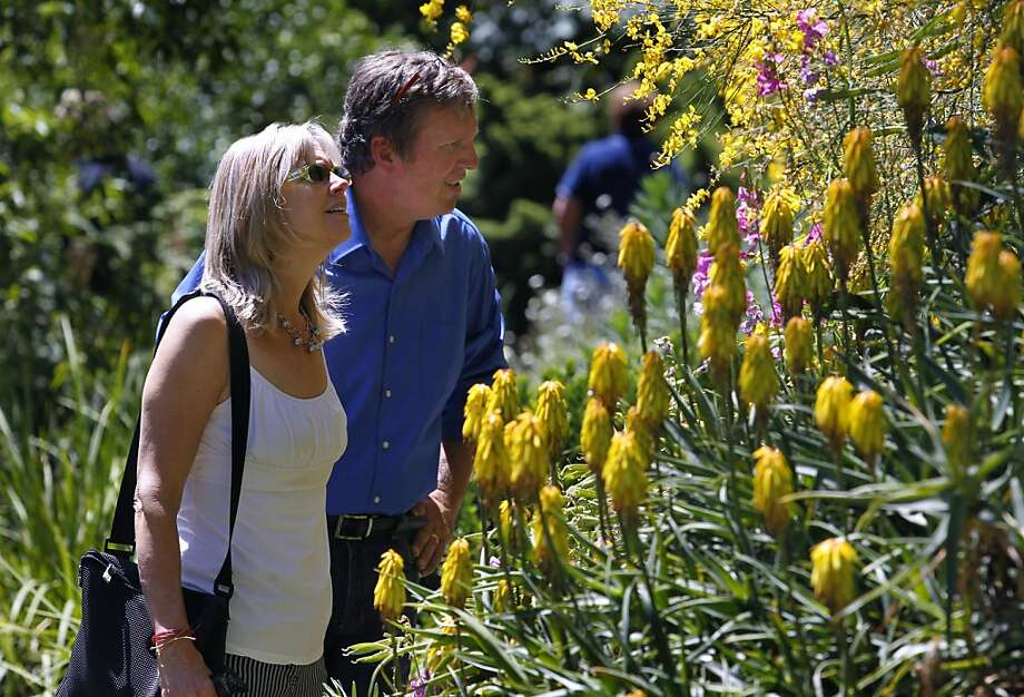 Ron and Shannon Estill, of Santa Rosa, visit the Western Hills Garden in Occidental, Calif. on Saturday, July 7, 2012. Tim and Chris Szybalski recently reopened the three-acre garden after rescuing the property from foreclosure. Photo: Paul Chinn, The Chronicle