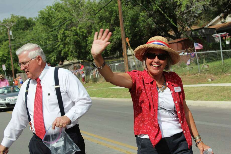 Leon Valley Fourth of July Parade Grand Marshall John Folks, who is retiring as superintendent of the Northside ISD, and Leon Valley Mayor Chris Riley walk the parade route down Poss Road, waving to parade watchers and passing out treats. Photo: Lauri Gray Eaton / Northwest Wee
