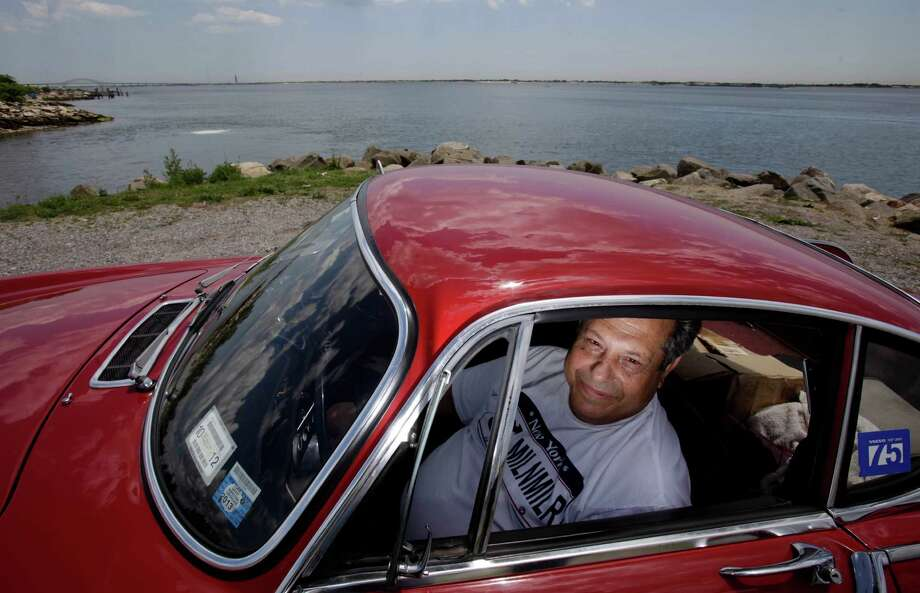 ***HOLD FOR FAY ABUELGASIM STORY*** Irv Gordon poses for a picture in his Volvo P1800 in Babylon, N.Y., Monday, July 2, 2012. Gordon's car already holds the world record for the highest recorded milage on a car and he is less than 40,000 miles away from passing three million miles on the Volvo. Photo: AP