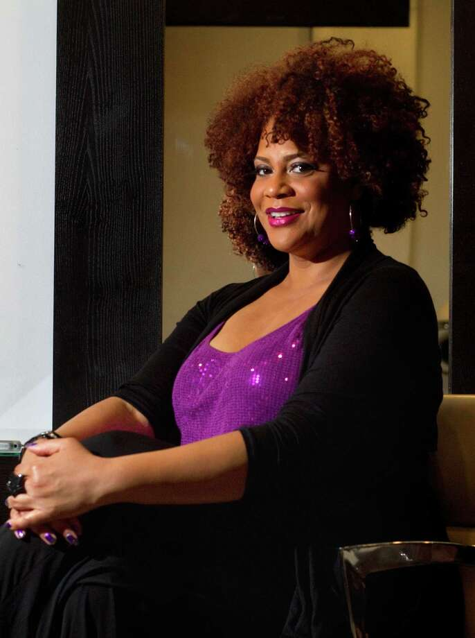 Actress-comedian Kim Coles spoke about celebrating natural hair. She was in Houston to address the Women's Empowerment Conference. Photo: Cody Duty / © 2011 Houston Chronicle