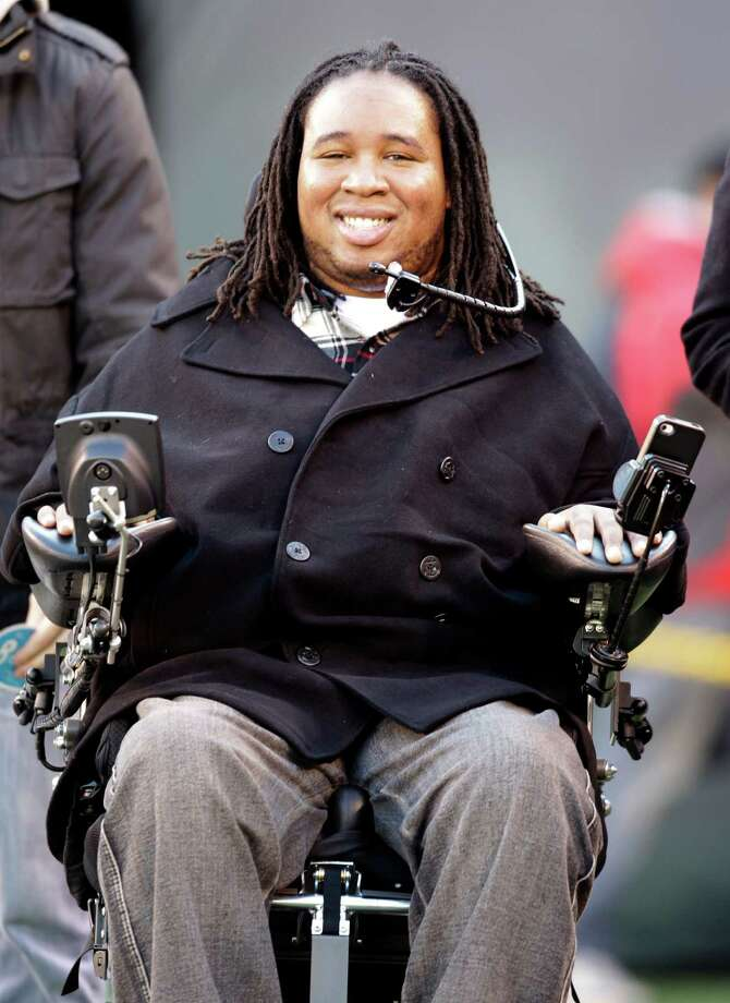 """FILE - This Dec. 24, 2011 file photo shows paralyzed former Rutger's football player Eric LeGrand smiling on the sidelines before an NFL football game between the New York Giants and the New York Jets, in East Rutherford, N.J. LeGrand has been selected to receive the Jimmy V Perseverance Award at the ESPYS next month. The Jimmy V Award is given to someone in sports who has overcome great obstacles through perseverance and determination. It is named for Jim Valvano, the North Carolina State coach who gave an emotional acceptance speech at the 1993 ESPYS that included his famous words """"Don't Give Up . . . Don't Ever Give Up!"""" Photo: AP"""