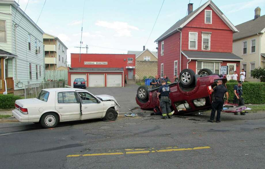A pregnant Bridgeport, Conn. woman was injured in a rollover crash on Dewey Street on Monday, July 9, 2012 after her SUV was struck by a car driven by a burglary suspect being pursued by Fairfield and Bridgeport police, Lt. Jim Perez said. Photo: Tom Cleary