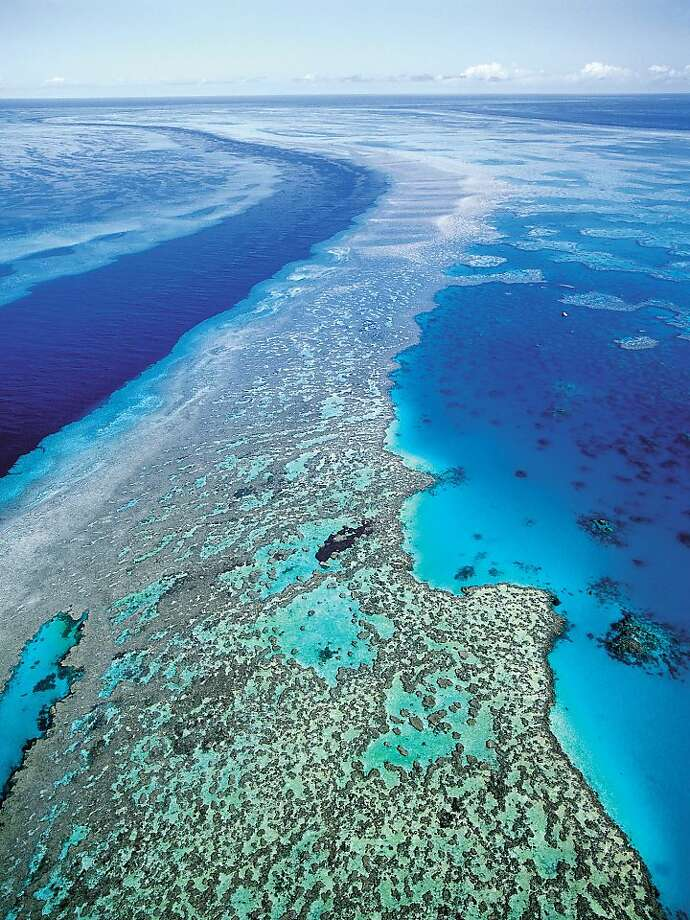 "FILE - In this Sept. 2001 file photo provided by provided by Queensland Tourism, an aerial view shows the Great Barrier Reef off Australia's Queensland state. Ocean acidification has emerged as one of the biggest threats to coral reefs across the world, acting as the ""osteoporosis of the sea"" and threatening everything from food security to tourism to livelihoods, the head of a U.S. scientific agency said Monday, July 9, 2012. (AP Photo/Queensland Tourism, File) EDITORIAL USE ONLY Photo: Queensland Tourism"