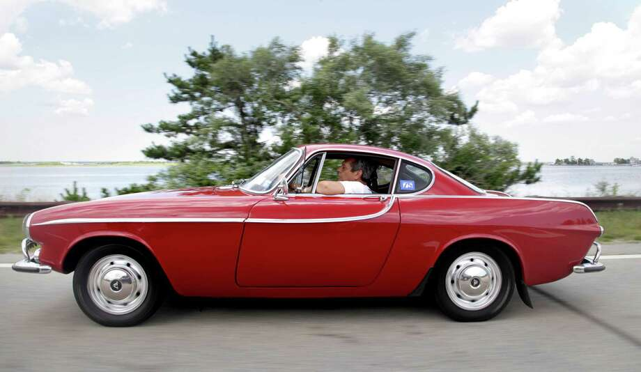 Irv Gordon drives his Volvo P1800 in Babylon, N.Y., Monday, July 2, 2012. Gordon's car already holds the world record for the highest recorded milage on a car and he is less than 40,000 miles away from passing three million miles on the Volvo.  (AP Photo/Seth Wenig) Photo: Seth Wenig