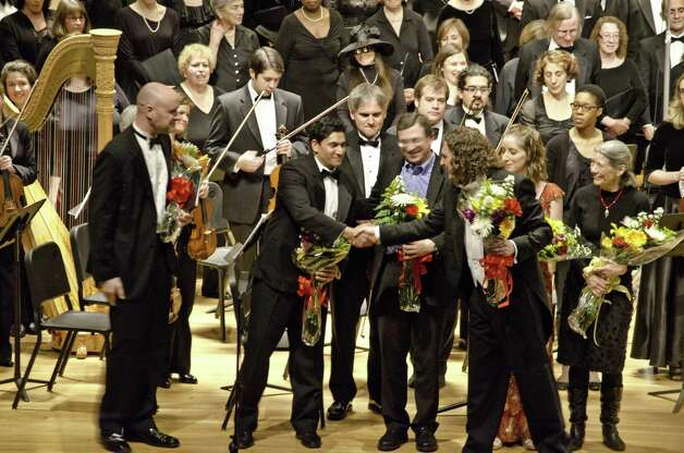 David Rosenmeyer, right, has been chosen music director/conductor of the Fairfield County Chorale. He will lead the group's 50th anniversary season. Shown here is a recent concert with the FCC. Photo: Contributed Photo