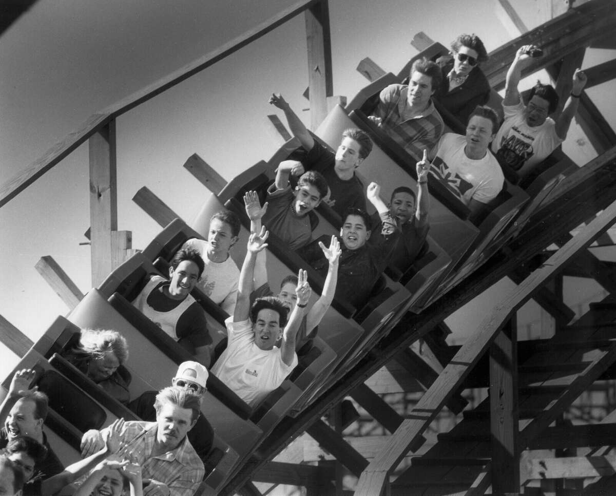Visitors at Fiesta Texas take The Rattler for a spin during the park's 'soft opening' debut on March 14, 1992. The wooden roller coaster was was modified less than two years later, after dozens of people claimed neck or back injuries. EXPRESS-NEWS FILE PHOTO