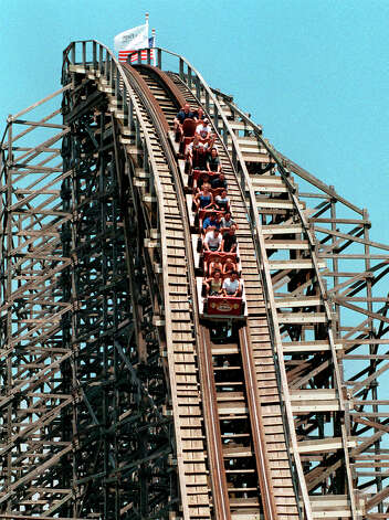 The Rattler rollercoaster at Six Flags Fiesta Texas in 1998. The Rattler's steepest drop when it opened in 1992 was 166 feet. It is currently 122 feet.  EXPRESS-NEWS FILE PHOTO Photo: Express-News