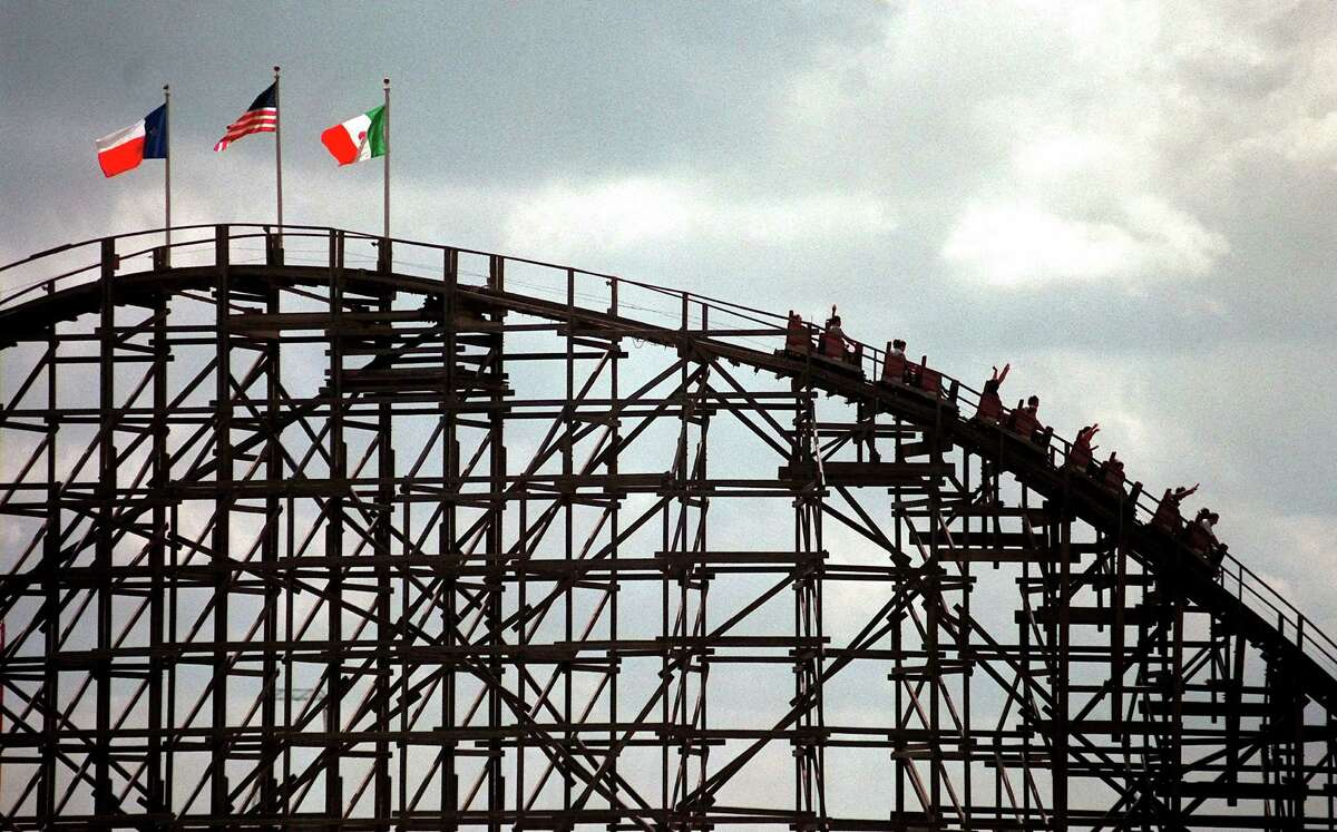Visitors to Six Flags Fiesta Texas enjoy the Rattler roller coaster in 1999. EXPRESS-NEWS FILE PHOTO