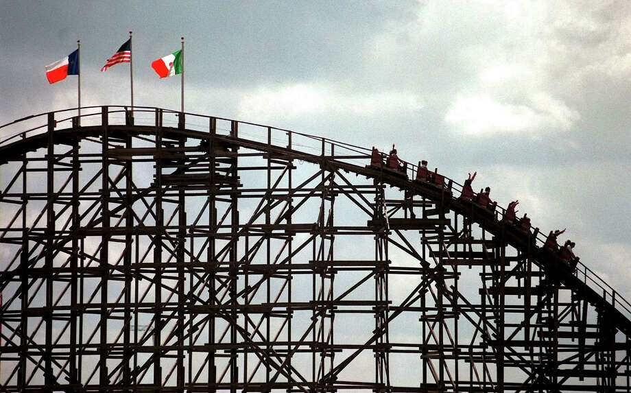 Visitors to Six Flags Fiesta Texas enjoy the Rattler roller coaster in 1999. EXPRESS-NEWS FILE PHOTO Photo: WILLIAM LUTHER, Express-News / EN