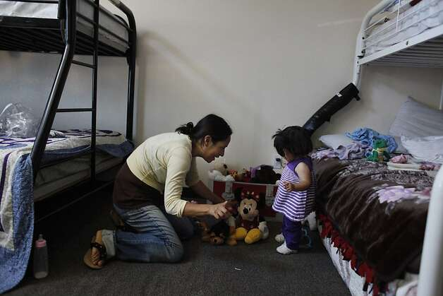 Socorro Quezada (l to r) talks with her daughter Deilayana Quezada, 16 months, in their emergency unit at the First Step for Families on Monday, July 9, 2012 in San Mateo, Calif.  First Step for Families is run by Inn Vision Shelter Network. Photo: Lea Suzuki, The Chronicle