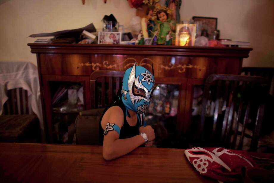 Young wrestler, 11-year-old Edgar Leal, poses for a photo before his performance in downtown Mexico City. Photo: Alexandre Meneghini, Associated Press / AP