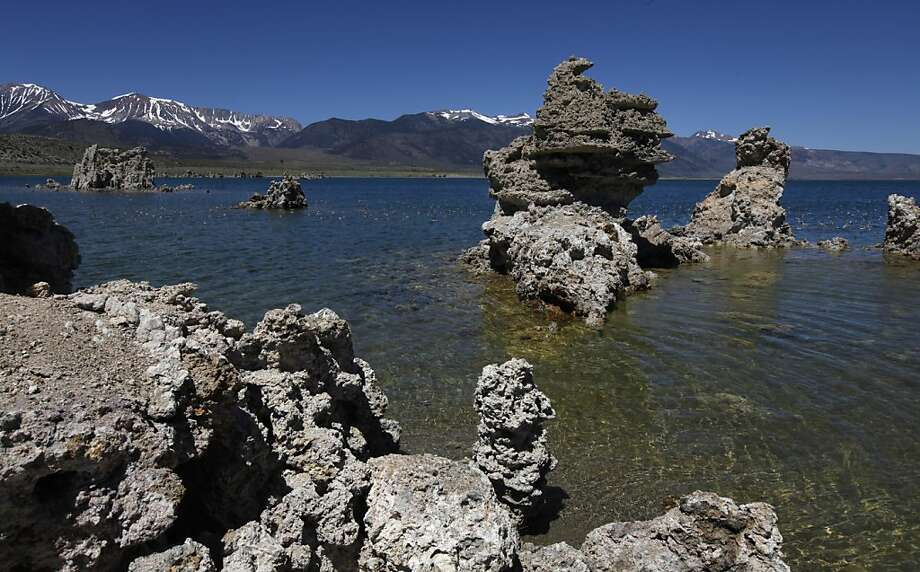 Jagged tufa formations rise from the lakebed at Mono Lake in Lee Vining, Calif. on Tuesday, July 19, 2011. The unique environment attracts over 270,000 visitors annually. Mono Lake Tufa State Natural Reserve is on the list of state parks that could be closed because of budget cuts. Photo: Paul Chinn, The Chronicle