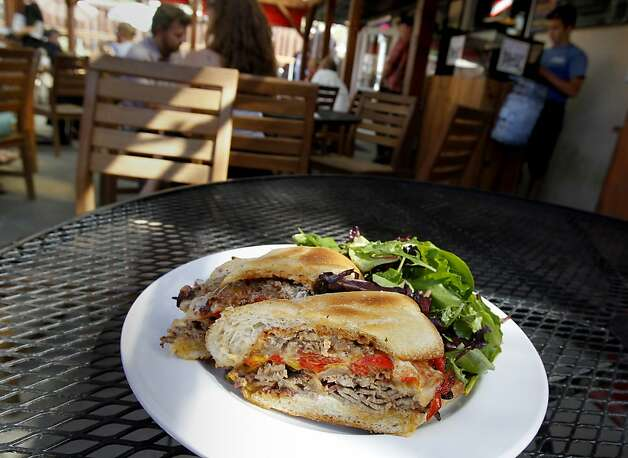 The beef brisket sandwich with a tossed salad is a favorite with beer. The Lagunitas Taproom and beer sanctuary is a delicious secret on the east side of Petaluma featuring their superb beer, live music, and entertaining food. Photo: Brant Ward, The Chronicle