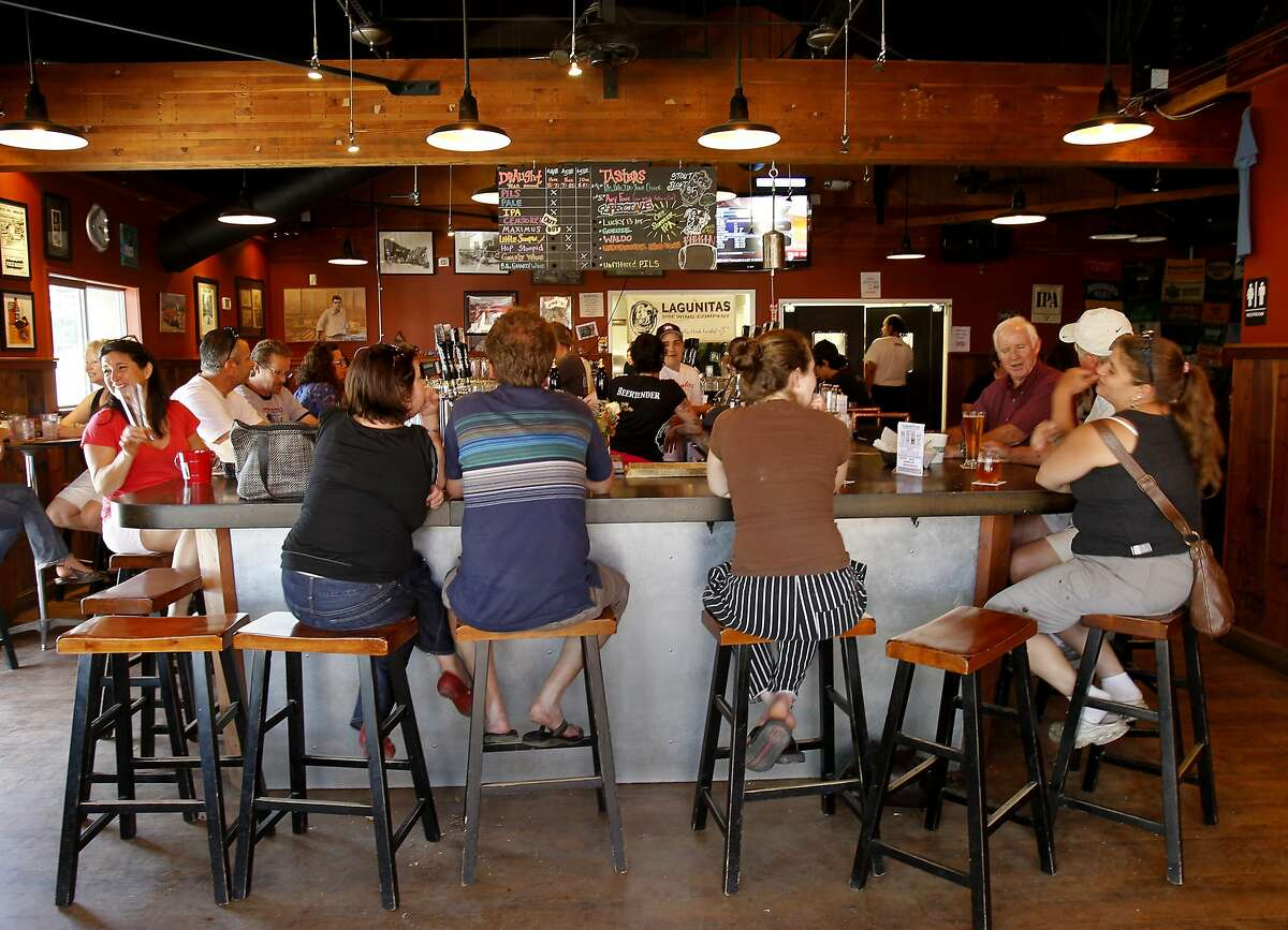 Even on a weekday afternoon, the Taproom is already jumping. The Lagunitas Taproom and beer sanctuary is a delicious secret on the east side of Petaluma featuring their superb beer, live music, and entertaining food.