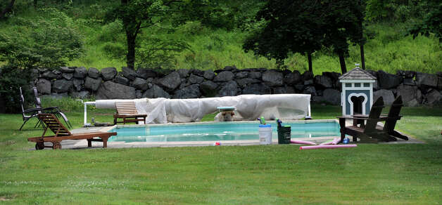 A swimming pool at a home on Ridgebury Road in Ridgefield is where the body of a missing man was found Monday, July 9, 2012. Photo: Carol Kaliff