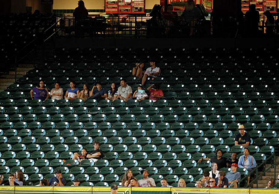 All those people who aren't at Minute Maid Park to cheer on the Astros are helping the cause by sending a loud message to management. Photo: James Nielsen / © 2012 Houston Chronicle