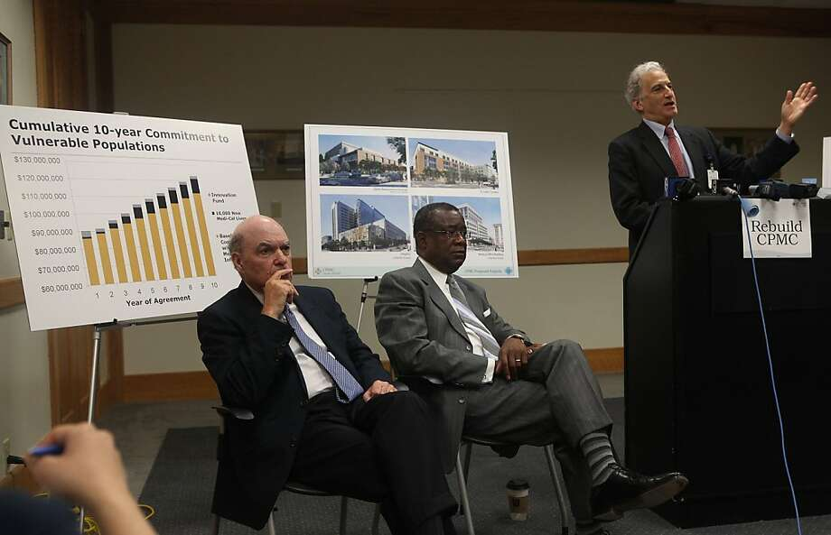 Sutter Health West Bay Region chairman Bob Tomasello (left), and Sutter West Bay Hospitals board member Anthony Wagner (middle) listen as Dr. Warren Browner (right), CEO of California Pacific Medical Center, at St. Luke's Hospital in San Francisco, Calif.,  talks about CPMC's commitment to honor development agreements approved by the planning commission and calling upon the board of supervisors to approve the multi-billion dollar earthquake safety rebuild program on Monday,  July 9, 2012.  Behind are graphics of the new hospital plans and designs. Photo: Liz Hafalia, The Chronicle