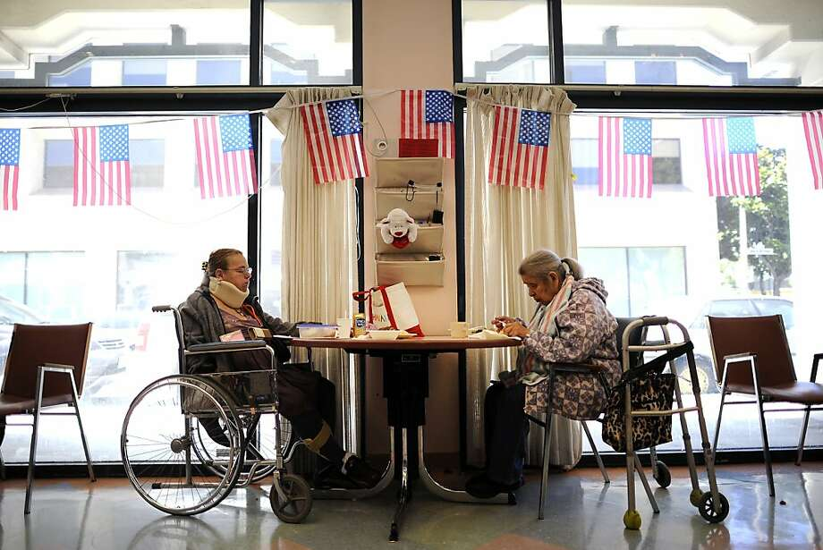 Cecilia Hernandez(L) and Esperanza Morazan sit together for lunch in the main room at the Adult Day Health Care Center in San Francisco CA Thursday June 28th, 2012. Photo: Michael Short, Special To The Chronicle