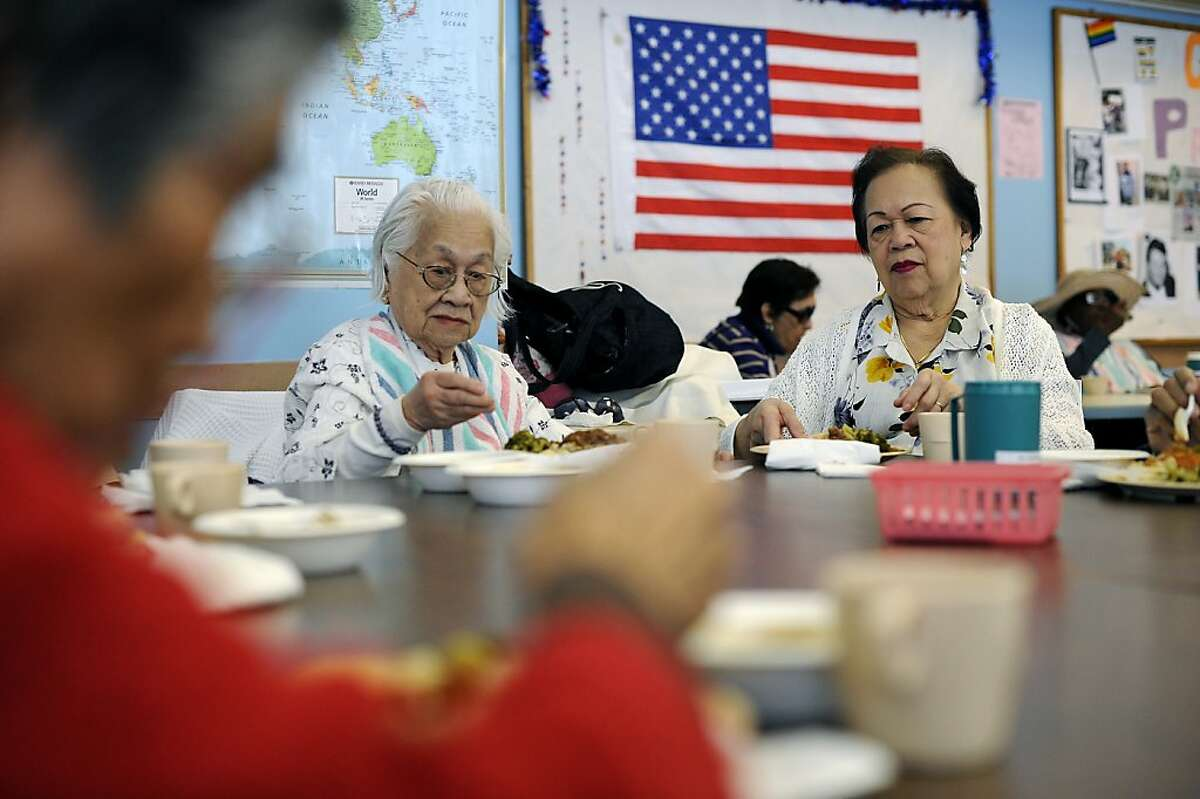 Hope Olson (right) and sister Fe Garcia have lunch at the Adult Day Health Care Center in San Francisco.
