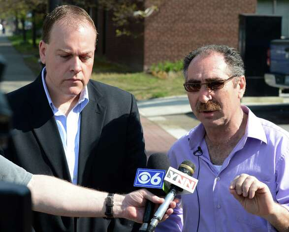 Co-defendants Edward McDonough, left, and Michael LoPorto hold a press conference outside the Troy, N.Y. city police department April 16, 2012.  (Skip Dickstein / Times Union) Photo: SKIP DICKSTEIN