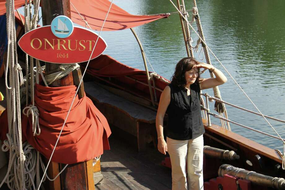 Greta Wagle, director of the Onrust Project, stands on board the ship docked at Lock 2 in Waterford. (Christopher Lisio)
