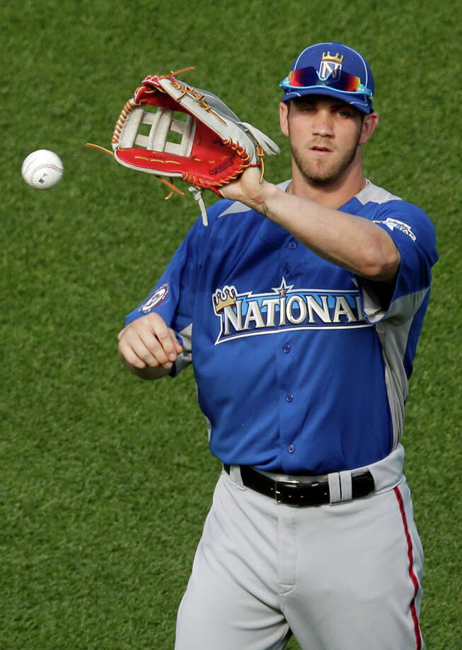 National League's Bryce Harper, of the Washington Nationals, warms up during MLB All-Star baseball batting practice, Monday, July 9, 2012, in Kansas City, Mo. (AP Photo/Charlie Riedel) Photo: Charlie Riedel