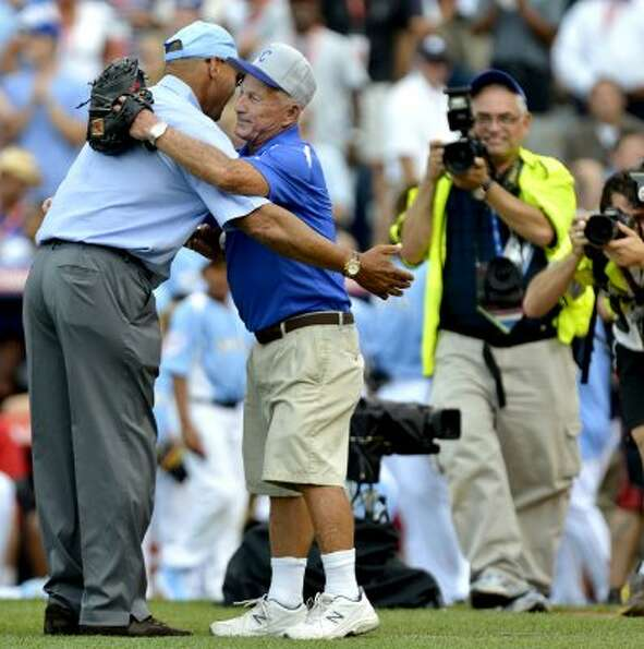 Kansas City Royals ground keeper George Toma, right, received a hug from Reggie Jackson during Monda